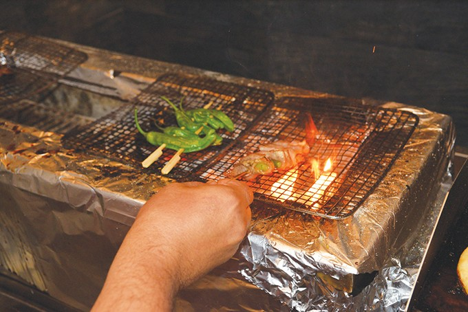 The charcoal grill at Ok-Yaki reaches temperatures up to 900 degrees Fahrenheit. - JACOB THREADGILL