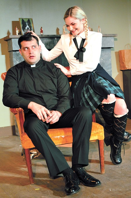 Girleen (Alexis Perry) surprises Father Welsh (Matthew Moreillon) with her teasing in The Lonesome West. - CARPENTER SQUARE THEATRE / PROVIDED