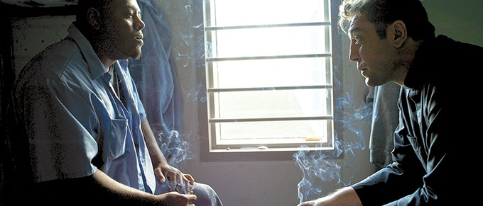 right Actor Javier Bardem speaks with an Osage County Jail inmate during the filming of Thy Kingdom Come. - PROVIDED