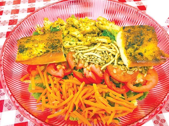The Bangkok Thai salad with garlic bread - JACOB THREADGILL