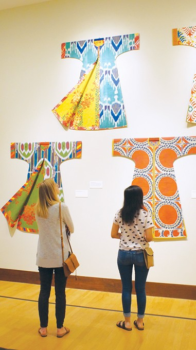 Museumgoers view a portion of Isabelle de Borchgrave's recreations of historical fashion by early 20th-century Spanish designer Mariano Fortuny. - MEG CHERIE