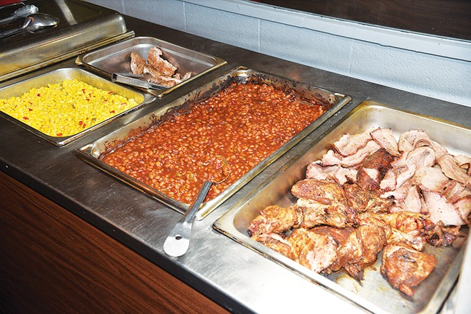 The Wednesday barbecue buffet features brisket, chicken and - country-style pork ribs along with corn, beans and other sides. - JACOB THREADGILL