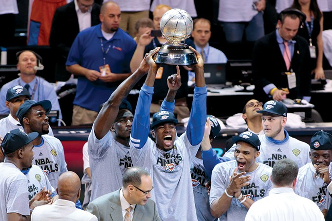 Kendrick Perkins and Serge Ibaka hold the 2012 Western Conference Championship trophy in 2012. - PROVIDED