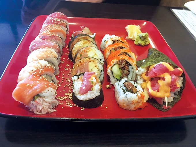 from left Rainbow rolls, spicy yellowtail, spider rolls and a spicy tuna hand roll at Shawn's Sushi - JACOB THREADGILL