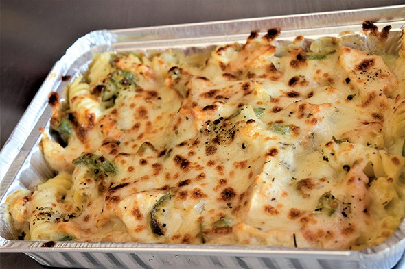 Baked spicy chicken sausage in a takeout container from Pasta 2 Go. - PROVIDED