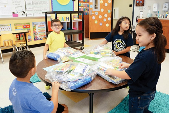 Dane & Associates Electric Company purchased school supplies for Pierce Elementary School students through The Foundation for Oklahoma City Public Schools' Kit-A-Kid program. - PROVIDED