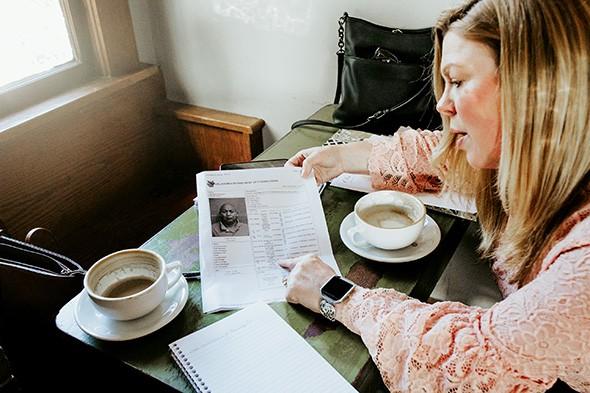Lauren Layman looks through the criminal records of her great-grandmother's suspected killer. - ALEXA ACE