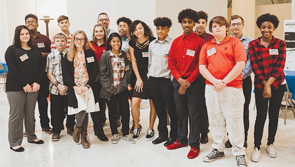 Aaron Baker's eighth-grade civics class from Del Crest Middle School gathered at the capitol Dec. 7 to advocate for an update to the state's AIDS education mandate. - ALEXA ACE