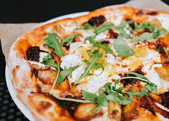The breakfast pizza features local eggs, potatoes and nduja, a spreadable Italian sausage. - PROVIDED