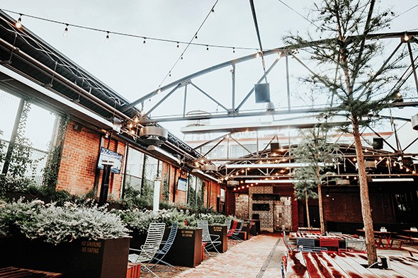 The Jones Assembly's event menu features food you can walk around with, including margherita pizza, a roasted pork sandwich and herb frites with goat cheese and bacon. - PROVIDED