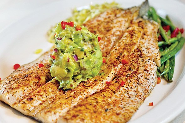 The blackened trout is topped with an avocado kiwi salsa that is like a sweet guacamole. - PASEO GRILL / PROVIDED