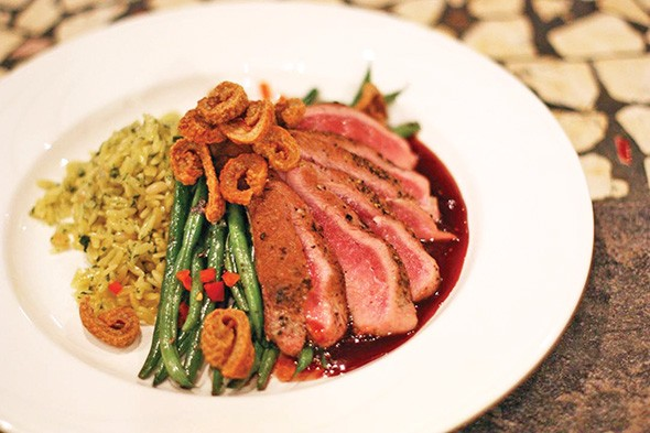 The seared duck breast is co-owner Lesley Rawlinson's favorite dish on the menu. - PASEO GRILL / PROVIDED