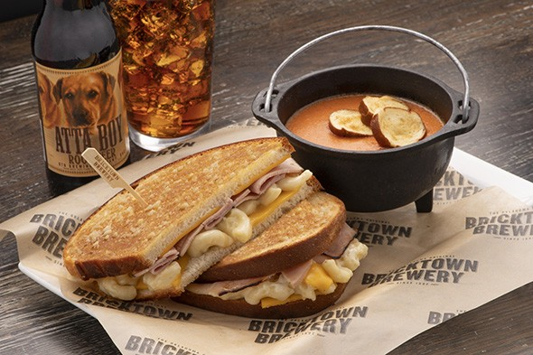 The new Twisted Comfort Foods grilled cheese features ham and macaroni and cheese with San Marzano tomato soup. - PROVIDED