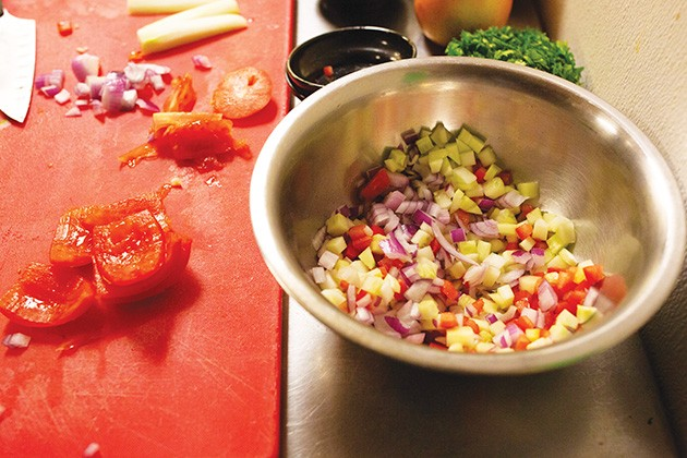 Ingredients of the ceviche are mixed together with cannabis-infused cilantro olive oil to create the medicated taco. - ALEXA ACE