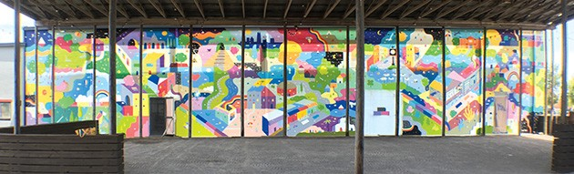 Kristopher Kanaly painted a 20-foot mural on one of the building's walls. - PETE BRZYCKI