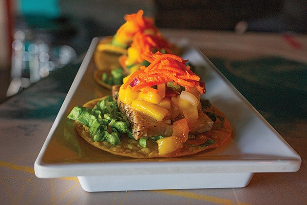 Tuna tostadas topped with mango salsa made with cannabis-infused chili oil - ALEXA ACE