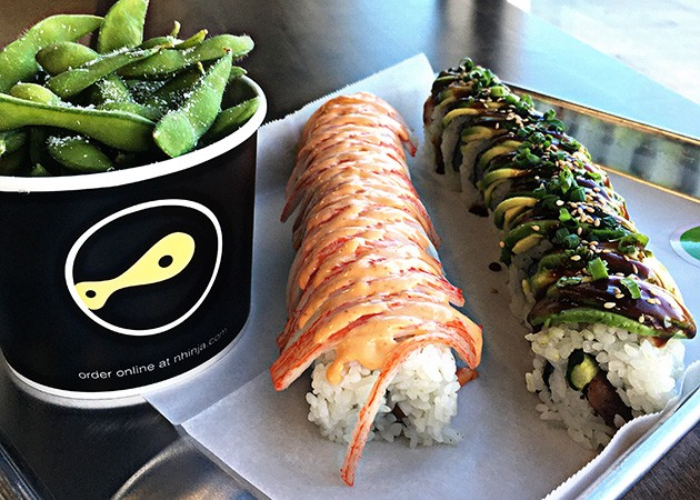Thunder and Tiger rolls made with the help of two automated machines at Nhinjo Sushi and Grill in Moore. - JACOB THREADGILL