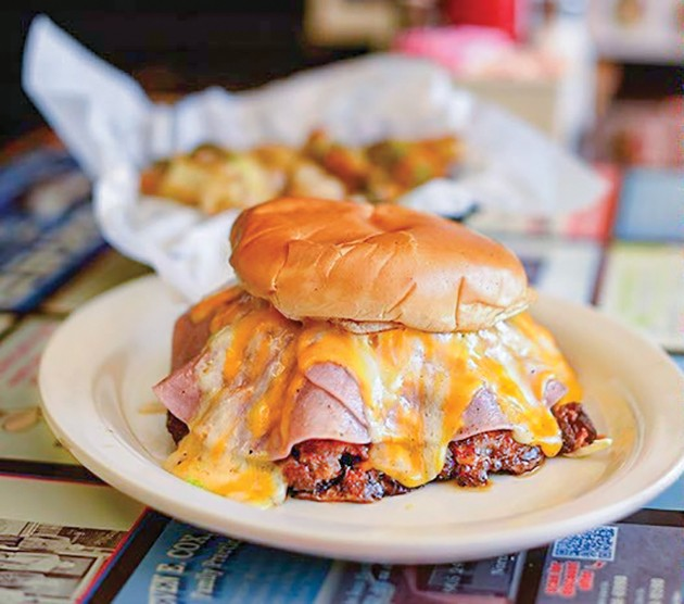 A Buster Burger is a sausage burger topped with ham, chili and cheese. - PROVIDED