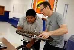 High school classes teach youth bicycle repair in partnership Spokies