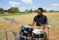 To the delight of his neighborhood, a local drummer practices in Quail Creek spillway