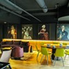 Artwork overlooks the second story of Bar Cicchetti that blends dining and lounge areas.