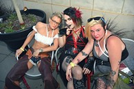 From left, Bonedust Cowgirl, Texas Chainsaw Mascara, and Pattsy CTown, attending the OKCMOA opening night rooftop party for the DeadCenter Film Festival, 6-11-2015.  Mark Hancock