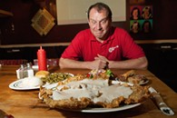 """Dee Downer, one of the partners who runs Kendall's, posses with """"Kendall's Chicken Fry Challenge"""".  mh"""