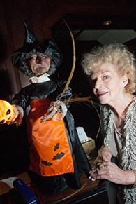 Hounted House owner Marian Thibault poses with a Witch of course, last October at the Haunted House.  mh