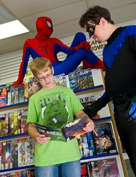 David Schmitz, as Spiderman, hangs out as Aiden Medlam talks with Sam Perry, as Nightwing, at New World Comics on Super Hero Saturday. - SHANNON CORNMAN