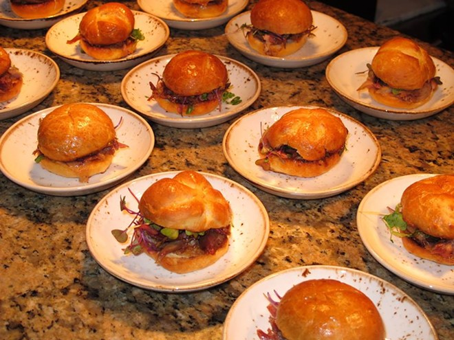 A table full of duck confit, foie mousse, and kumquat sandwiches prepared by chef Mariano Vegel of Primo - PHOTO BY FAIYAZ KARA