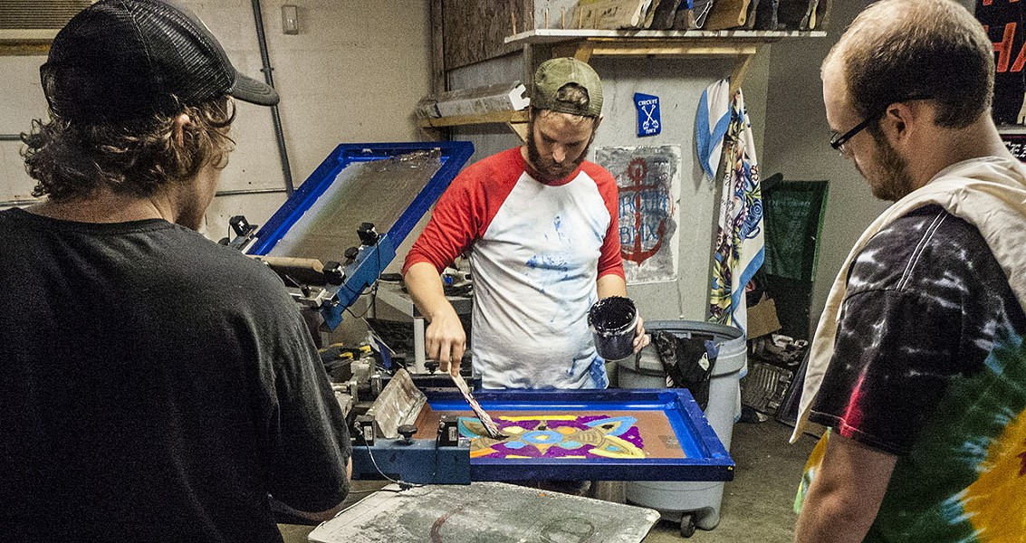 Aaron Sarkisian printing a Billy Richardson design at our grand opening - PHOTO COURTESY OF THE SPACE STATION