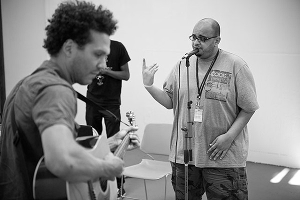 Ahmed Rock on the mic - PHOTO BY PATRICIA LOIS NUSS