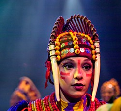 An actress in the Warthog section of the performance at the Animal Kingdom - PHOTO BY ERIC FROMMER VIA FLICKR