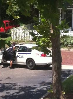 cops-outside-house-e1377625509409jpg