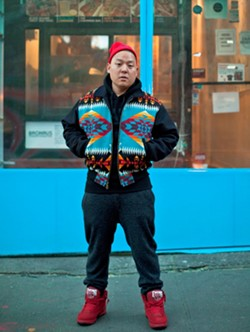 Eddie Huang in front of his New York restaurant - PHOTO BY ATISHA PAULSON