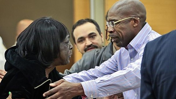 Fleming hugs his mother after being declared free following almost 25 years in prison.