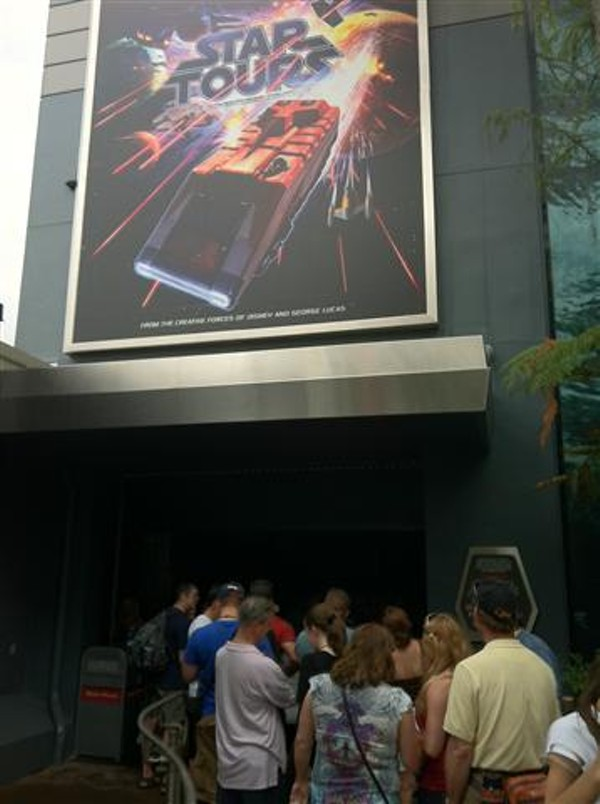 Guests line up for a preview of Disney's revamped Star Tours ride.