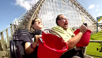 Two people take the ALS Ice Bucket challenge while riding an Orlando coaster