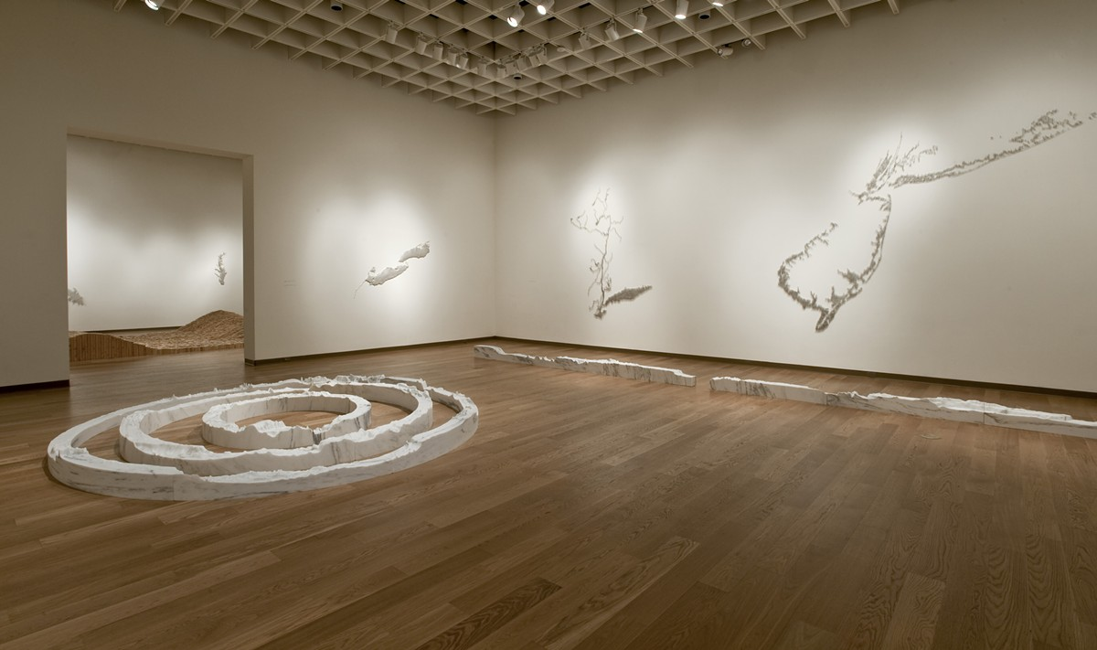 Installation view of the exhibition: Maya Lin: A History of Water, Orlando Museum of Art January 31–May 10, 2015. Foreground in marble: Around the World, 2013-2014; 74° West Meridian, 2013; and 106° East Meridian, 2013. On the wall (left to right): Silver Niagara, 2012-2013; Pin River – Hudson, 2013; and Pin River – Sandy, 2013, © Maya Lin Studio, courtesy Pace Gallery.
