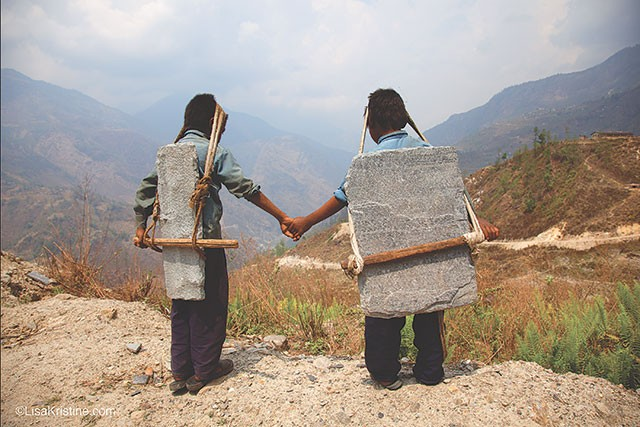 "Lisa Kristine: ""Brothers Carrying Stone, Nepal"""