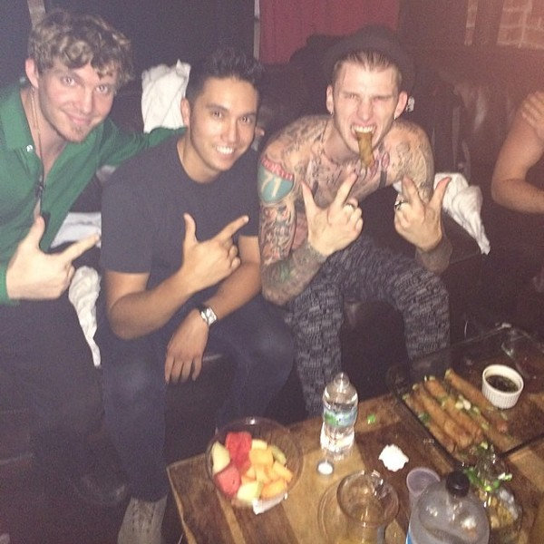 Machine Gun Kelly chowing down on one of Biondi's traditional fried spring rolls.