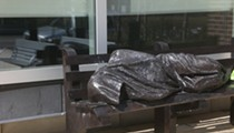 Homeless Jesus sleeping on a bench statue to be installed where homeless aren't allowed to sleep on benches