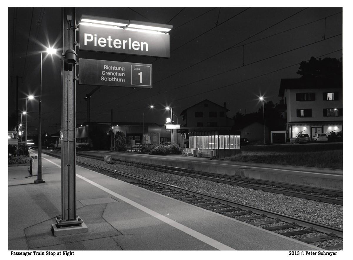 """Passenger Train Stop at Night"""