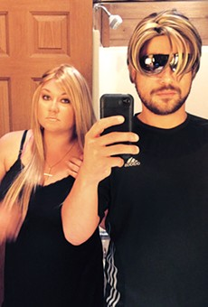 Photo of Photo of Robert Zimmerman and Shellie Zimmerman trying on wigs via