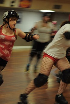 Playing nice: The Bellevue Bombshell jammer known as 'Ellen Rage' passes by Serial Thriller player 'Knock'em Over Clover' during a practice bout in October.