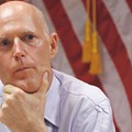 """Some hesitation"": Gov. Rick Scott signs online voter registration bill, but does so with a frown"