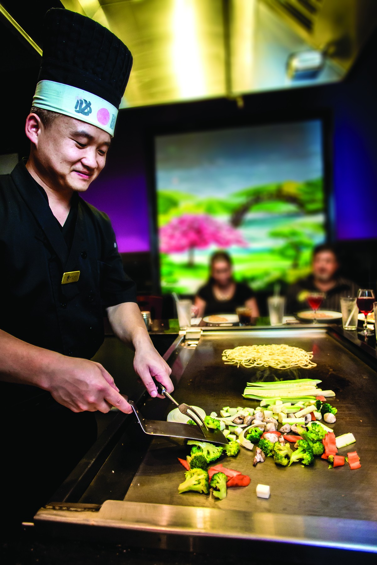The cover of BITE 2015 features a photo from the teppanyaki grill at A-Aki Japanese Sushi and Steakhouse.