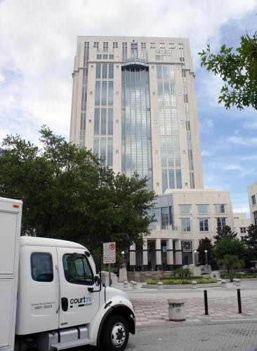 "The Orange County Courthhouse at which Schmidter had been handing out Fully Informed Jury Association flyers outside of designated ""exempt zones."""