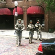 SWAT team action at 55 West: officers were shot at but suspect's gun jammed