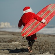 Catch a wave of Christmas cheer at Cocoa Beach's annual Surfing Santas event